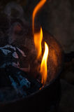 Charcoal flame and ember. An iron bucket full of charcoal dark with some flames ember and ash Stock Photo