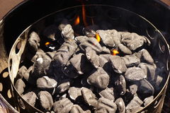 Charcoal with flames. Royalty Free Stock Photos