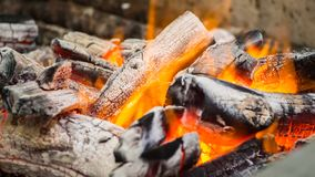 Charcoal. Flaming Charcoal In BBQ Grill Pit stock image