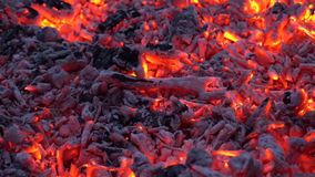 Charcoal glowing with colorful orange light in firewood bonfire flame fireplace in incredible satisfying close up shot stock footage