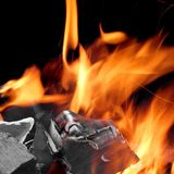 Charcoal Glowing With Flames Of Fire  On Black Royalty Free Stock Images