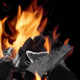 Charcoal Glowing With Flames Of Fire Isolated On Black Stock Images
