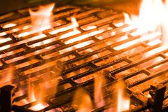 Charcoal grill. Closeup of charcoal burning under a barbecue grill Stock Photos