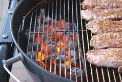 Charcoal grill. Glowing charcoal with loin of pork royalty free stock images