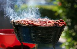 Charcoal grill carne asada grilling in the streets of Miami Beach south Florida. Family asado with coal Stock Photo