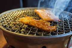 Charcoal Grill Pork. With smoke in korean restaurant Royalty Free Stock Images