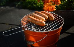 Charcoal Grill With Sausage stock photos
