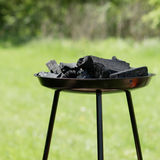 Charcoal in a grill. On a sunny glade in summer Royalty Free Stock Photos