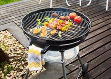 Charcoal grill on terrace royalty free stock photos