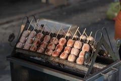 Charcoal grilled rice sausage. Street food at walking street market Koh Phangan, Thailand Royalty Free Stock Image