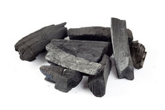 Charcoal heap. On a white background Stock Photos