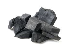 Charcoal. Many pieces of charcoal isolated on white background royalty free stock photo