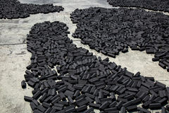 Charcoal pack bar made from coconut shell dry in the sun Stock Images