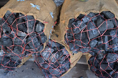 Charcoal packed in sacks Royalty Free Stock Image