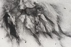 Charcoal powder on paper. Abstract artistic textured background created by throwing charcoal powder onto paper stock images