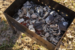 Charcoal preparation for bbq in mangal. Outdoor picnic Royalty Free Stock Photography