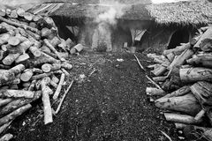 Charcoal Production. Bunch of woods was using to make charcoal in Kelantan, Malaysia Royalty Free Stock Photos