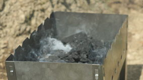 Charcoal put in the brazier with a blazing fire stock video footage