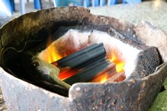 Charcoal in the roaster. Charcoal in the toaster or roaster royalty free stock photography