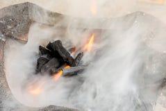 Charcoal and smoke Stock Photography