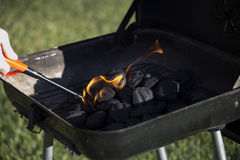 Charcoal Starting to Flame. Person starting barbecue grill flame Royalty Free Stock Photo