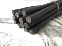 Charcoal Sticks 1. A bunch of artists' charcoal sticks on a sketch pad royalty free stock photo