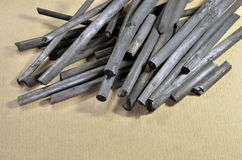 Charcoal sticks. Natural charcoal sticks used for artistic drawing on paper. Art paper as background Royalty Free Stock Image