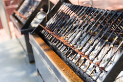 Charcoal stove and gridiron for barbecue grilling Royalty Free Stock Photo