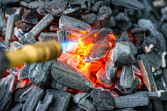 Charcoal is switched on. Some Charcoal is switched on in the garden Royalty Free Stock Images