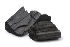 Charcoal. Three pieces of charcoal on white stock image