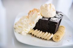 Charcoal toast with ice-cream, fresh banana and whipped cream. Dessert royalty free stock image