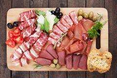 Charcuterie board. Charcuteri board with prosciutto, capicola and other italian deli cured meat Stock Photos