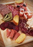 Charcuterie board with cured meat Royalty Free Stock Photos