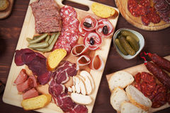 Charcuterie board with cured meat. Bread and olives Royalty Free Stock Images