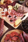 Charcuterie board with cured meat and olives Stock Image