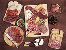Charcuterie board with cured meat and olives Royalty Free Stock Photography
