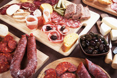 Charcuterie board with cured meat and olives Stock Images