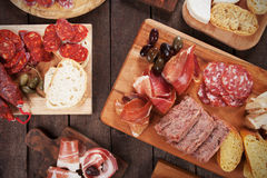 Charcuterie board with cured meats. Bread and olives Stock Photography