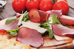 Charcuterie board with italian bresaola Stock Photography