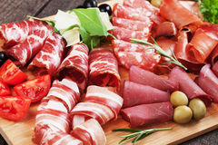 Charcuterie board. With italian style cured meat, pancetta, bresaola,capocollo,sausage and prosciutto Royalty Free Stock Images