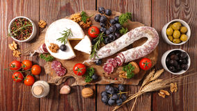 Charcuterie and cheeses. On wood Royalty Free Stock Image