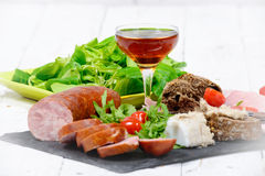 Charcuterie plate with  glass of wine Royalty Free Stock Images
