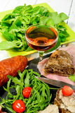 Charcuterie plate with  glass of wine Stock Image