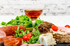 Charcuterie plate with  glass of wine Stock Photo