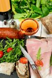 Charcuterie plate with  glass of wine Stock Photos