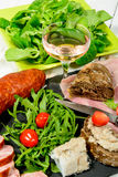 Charcuterie plate with  glass of wine Royalty Free Stock Photos