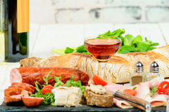 Charcuterie plate with wine Royalty Free Stock Photos