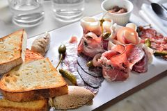 Charcuterie Platter Cold dish. French Charcuterie Platter ham and toast Stock Photography