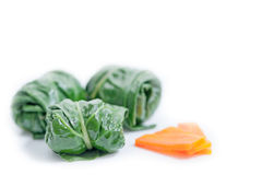 Chard rolls with carrot isolated on white Stock Photos