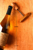 Chardonnay Bottle and Corkscrew on Wood Background Royalty Free Stock Photos